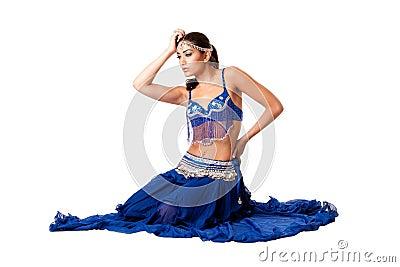 Belly dancer sitting in blue dress