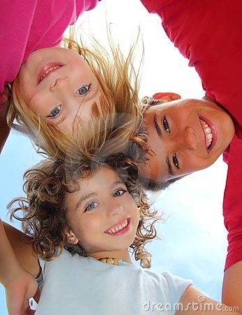 Free Below View Of Happy Three Children Embracing Royalty Free Stock Image - 16383546