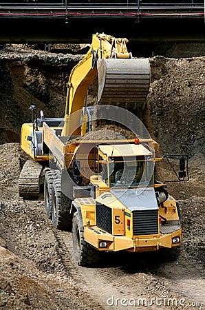 Belt excavator loading a big dumper