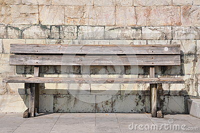 Bench against the wall, loneliness