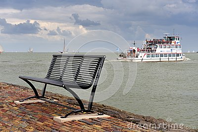 A bench and the boat in the Netherlands