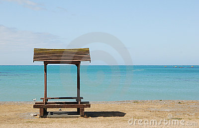Bench at empty beach