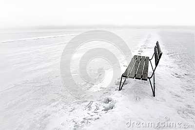 Bench on frozen lake
