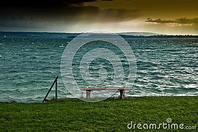 Bench on lake shoreline