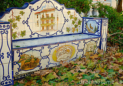 Bench surrounded by leaves