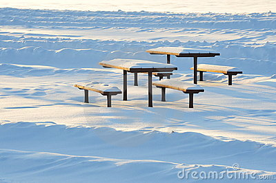 bench and table in snow waves