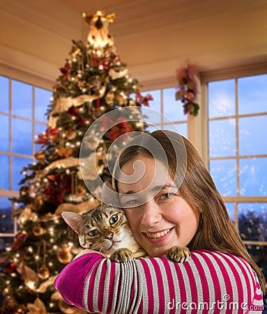 Bengal cat on girls arm
