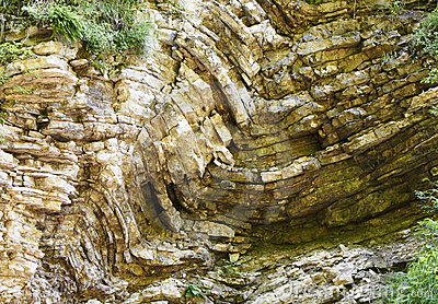 The bent layers of rock