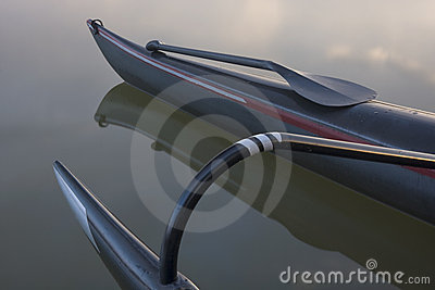 Bent shaft paddle and racing outrigger canoe
