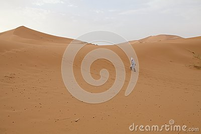 Berber man and dunes Editorial Photography