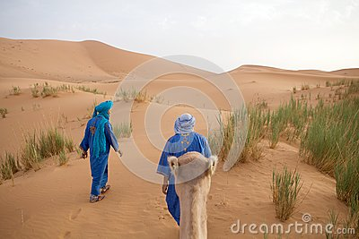 Berber men with camel Editorial Photography