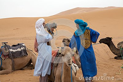 Berber men with camel Editorial Image