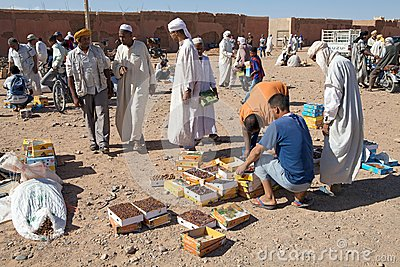 Berber men at the dates fruit market Editorial Stock Photo