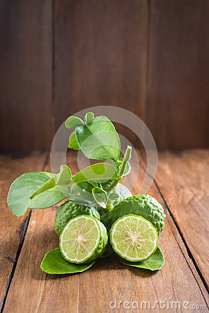 Free Bergamot With Green Leafs On Wood Background Stock Image - 57836231