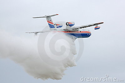 Beriev dropping water at Paris Air Show 2011 Editorial Photo