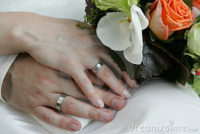 Beringed hands of a bridal couple