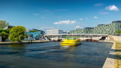 BERLIN, GERMANY - MAY,2019: Timelapse view of a bridge over Spree River, with boats in the city centre near Bundestag. BERLIN, GERMANY - MAY,2019: Timelapse stock footage