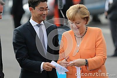 BERLIN - SEP 11: Philipp Rösler and Angela Merkel Editorial Stock Photo