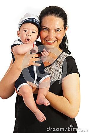 Überraschtes Baby der Mutter Holding