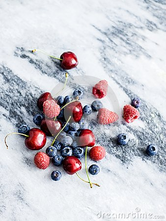 Free Berries And Cherries On A Marble Slab Stock Photos - 103474493