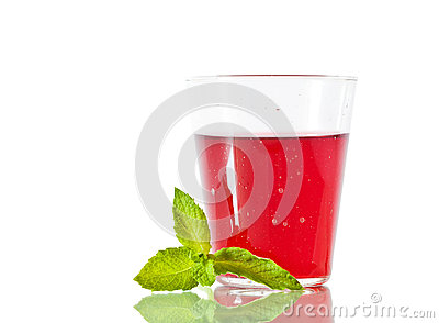 Berry compote with mint in glass