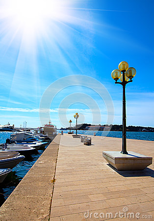 Berth with street-lamp on sea