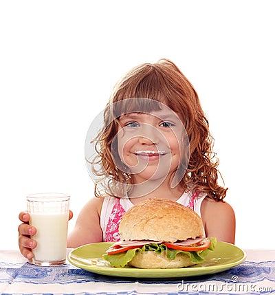 Besmear little girl with sandwich