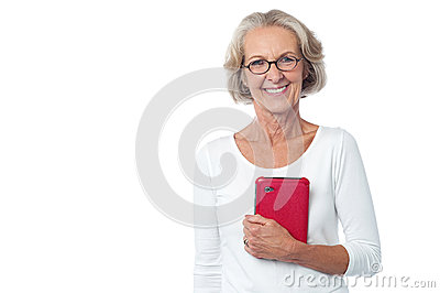 Bespectacled lady posing with tablet pc