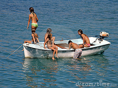 Best friends in boat at sea