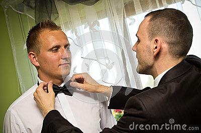 Best man dressing groom