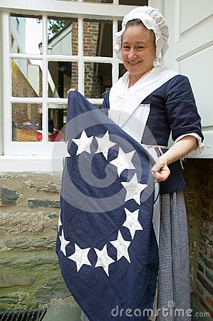 Betsy Ross actor holds colonial flag Editorial Image