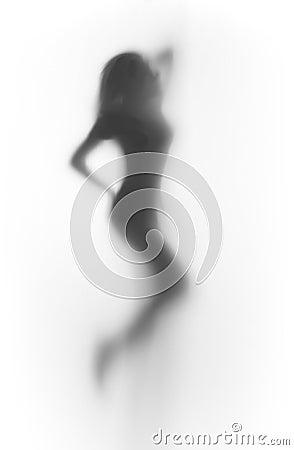 Beutiful dancer woman silhouette behind a curtain
