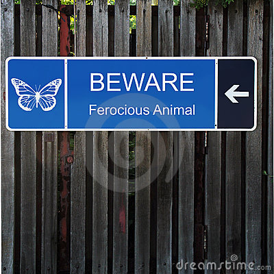 Beware Horizontal Blue Sign on Old Wood Fence