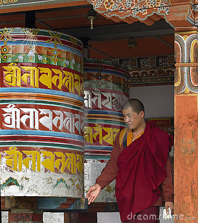 Free Bhutan - Buddhist Monk Turning Prayer Wheels Royalty Free Stock Photography - 15601127