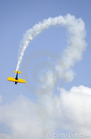 Free Bi-plane And Curved Smoke Trail Stock Photos - 518203