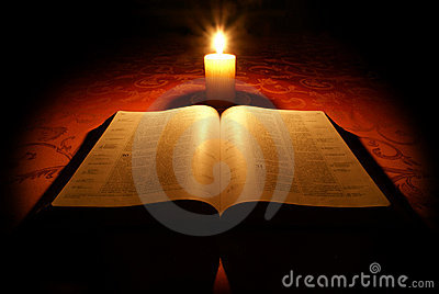 bible and candle royalty free stock photography image