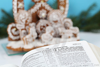 Bible and gingerbread nativity scene
