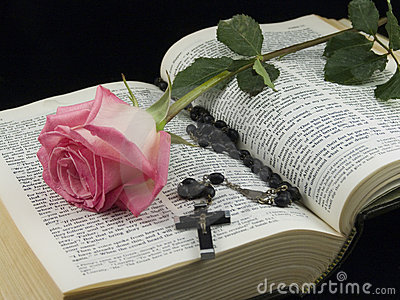 Bible with rose and crucifix