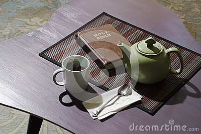 Bible with teacup and teapot