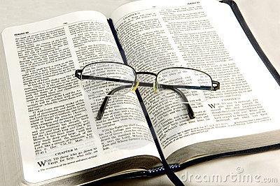 Bible whit eye glasses.