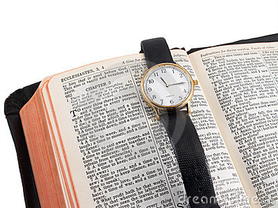 Bible and wristwatch