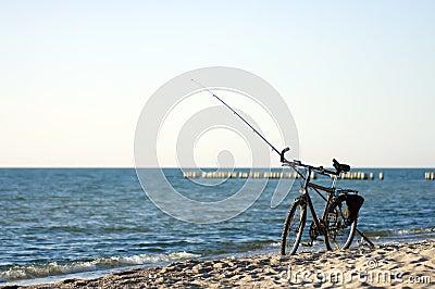 Bici y barra de pesca