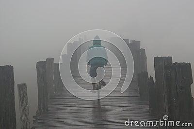 Bicycle on bridge in fog