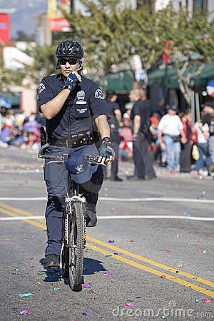 Bicycle Cop doing Crowd Control Editorial Photography