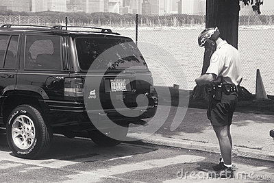 Bicycle cop writing ticket Editorial Stock Photo