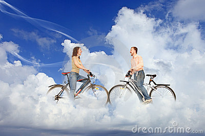 Bicycle couple man and woman meeting on clouds
