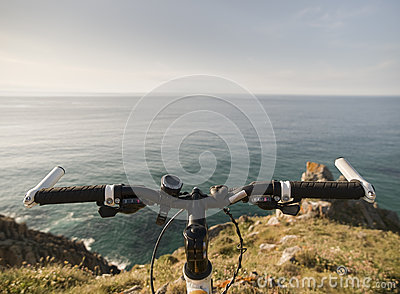 Bicycle handlebars and a coastal landscape