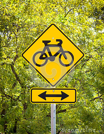Bicycle Lane Sign in front of greenery