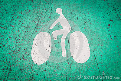 Bicycle lane symbol on the ground.