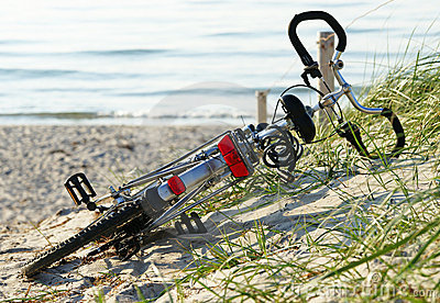 Bicycle laying at the beach